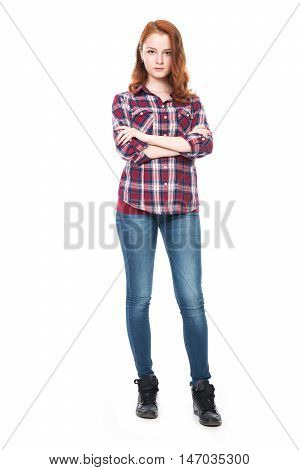 Young pretty curly woman in plaid shirt and jeans posing. Beautiful girl in full-length isolated on white background
