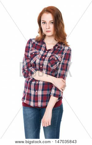Young pretty curly woman in plaid shirt and jeans posing. Beautiful girl isolated on white background