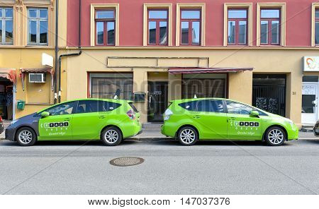OSLO, NORWAY - AUGUST 27, 2016: Green Taxi Cars on the street in Oslo.