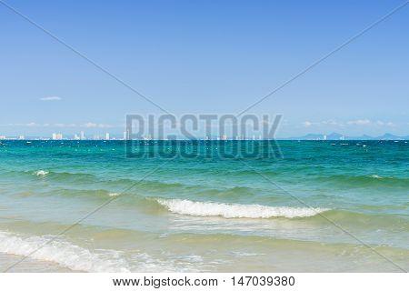 Turquoise sea wave foam on Kholan beach Pattaya Thailand. Thailand sea beach with sea foam Beautiful sea wave. Sea waves near beach.