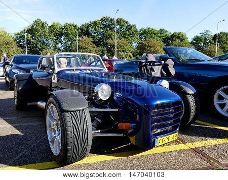 Amsterdam, The Netherlands - September 10, 2016: Dark Blue Vm 77 1992 On Display During Cars & Coffe