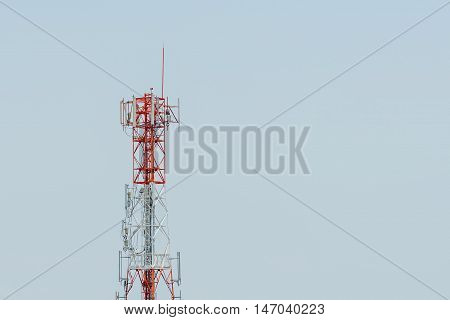 Telecommunication tower with clear sky on background.