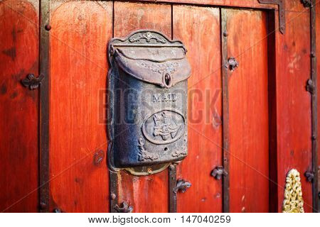 Black Vintage Post Box On Red Wall