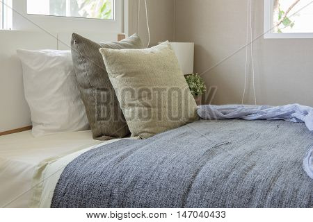 White Modern Bed With Pillows In Modern Single Bedroom
