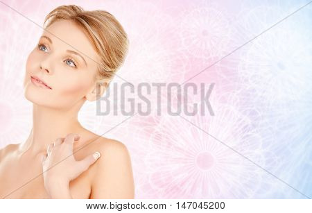 beauty, people and bodycare concept - beautiful young woman face and hands over rose quartz and serenity pattern background