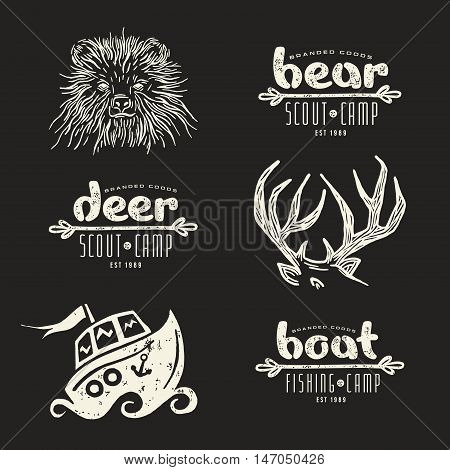 Set of elements in hand-drawn style: bear deer horn boat. Graphic design for t-shirt. White print on black background