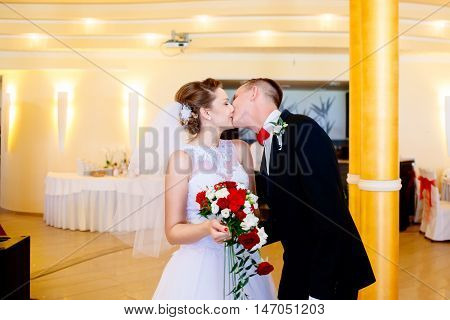 Newlyweds First Kiss On Wedding Party.