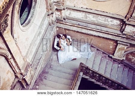 Newlyweds Near Old Stairs