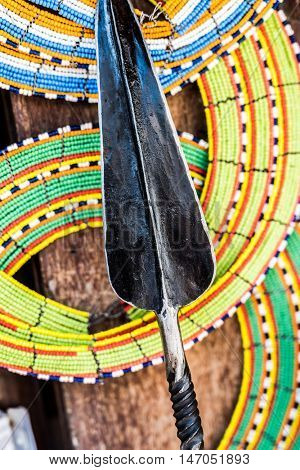 tnational african handmade colorful decorations and tribal spear on Zanzibar market