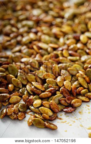Roasted spicy pumpkin seeds with cumin and brown sugar