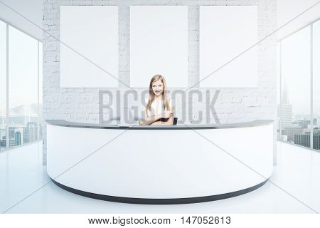 Cheerful businesswoman at reception desk with three blank posters in interior with white brick wall shiny floor and panoramic windows with city view. Mock up 3D Rendering