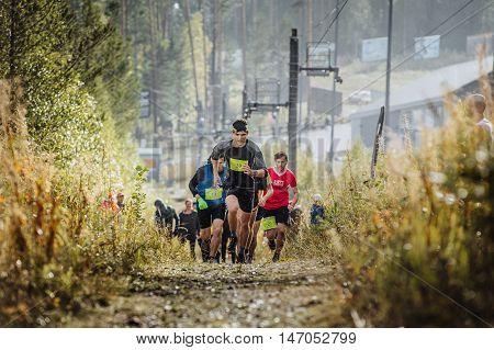 Revda Russia - September 10 2016: runner leader runs ahead group of athletes marathoners during marathon Vertical kilometer