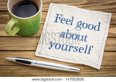 feel good about yourself advice or reminder - handwriting on a napkin with a cup of espresso coffee