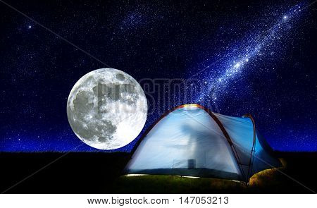 moon over meadow and milky way star