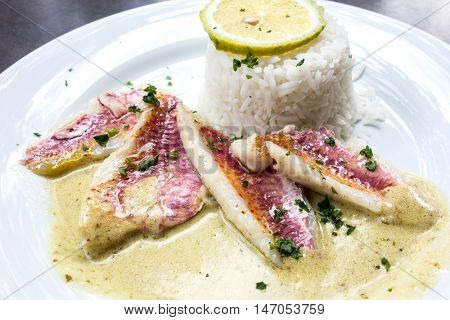 grilled fish and rice-french cuisine dish with lemon and fish
