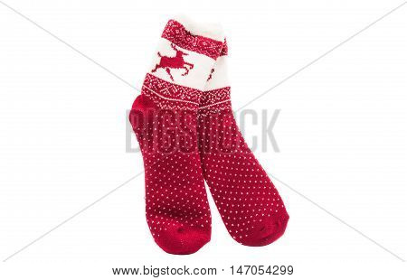Red knitted socks lying on a white background