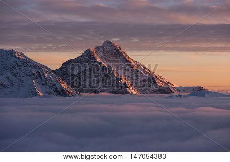 Kriváň at sunset . Slovak Tatra mountains. Inversion.