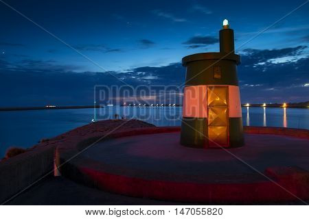 Landscape of Praia da Barra Aveiro District Portugal with navigation beacon in the foreground