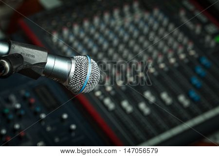 Microphone in front of a sound board