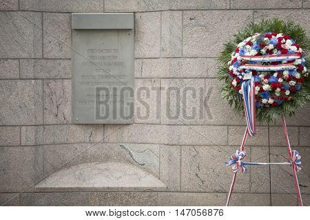 NEW YORK - SEPT 9 2016: The dedication plaque and ceremonial wreath placed at the NYC Police Memorial before the 9/11 Memorial Commemoration Service on the 15th anniversary of the terror attacks.
