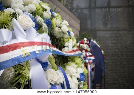 NEW YORK - SEPT 9 2016: Close up of the ceremonial wreaths for the 9/11 Memorial Commemoration Service placed at the NYC Police Memorial on the 15th anniversary of the terror attacks.