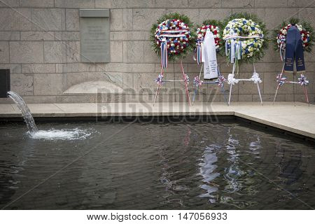 NEW YORK - SEPT 9 2016: Ceremonial wreaths for the 9/11 Memorial Commemoration Service placed near the water feature of the NYC Police Memorial on the 15th anniversary of the terror attacks.