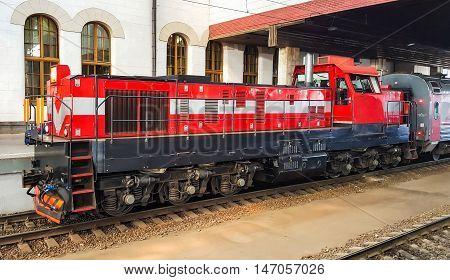 Passenger train on the station platform. Locomotive