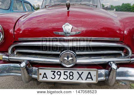 Kharkiv Ukraine - May 22 2016: Close up of the Soviet retro car cherry-blossom sedan GAZ M21 Volga First Series manufactured between 1956 and 1958 exhibited at the festival of vintage cars Kharkiv Retro Rally - 2016 in Kharkiv Ukraine on May 22 2016