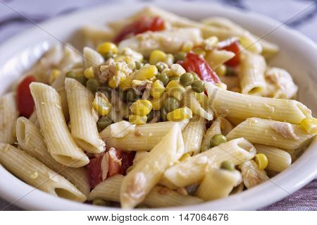 salad of pasta with peas, corn, tuna and tomato