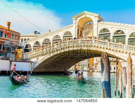 VIew of Canal Grande and famous Rialto Bridge at sunset in Venice, Italy