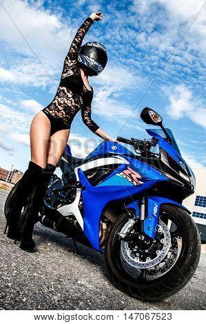 Sexy Young Woman Near The Suzuki Gsx-r750