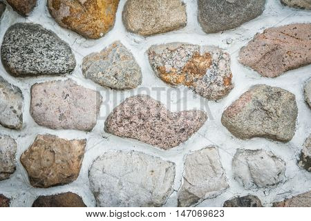 background of different stones in the masonry wall