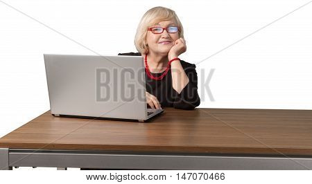 Friendly Old Woman Sitting behind Table and Using Laptop - Isolated