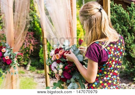 Decorator Working With Flowers Composition For Wedding Arch