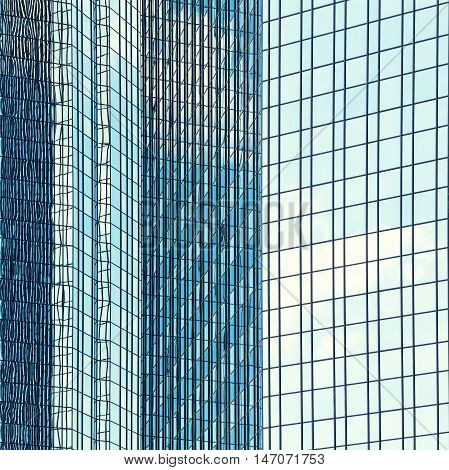 Abstract view of modern facade glazing with sky reflection