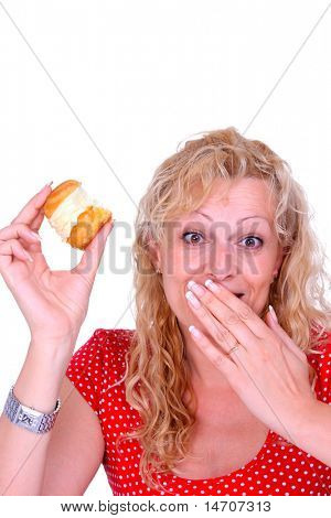 Hungry gluttonous woman eating cake