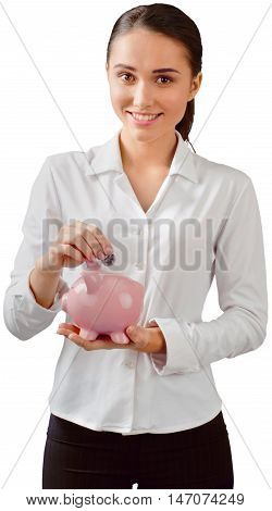 Woman Inserting Coin in a Piggy Bank - Isolated