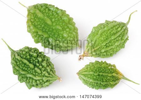 four green bitter melon or momordica isolated on white background.