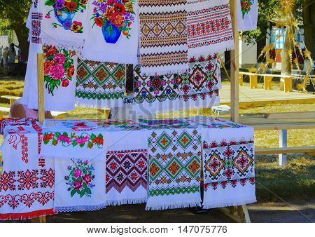 Sale of hand-embroidered fabrics at the fair in the village