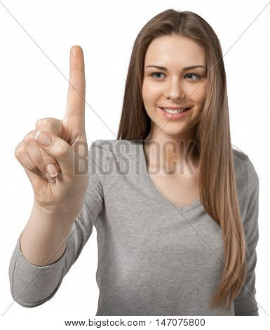 smiling young woman holding her index finger up