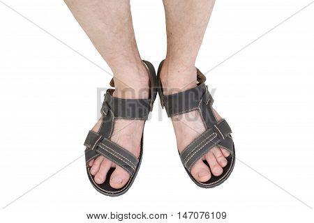 Closeup man's feet wearing primitive black sandals
