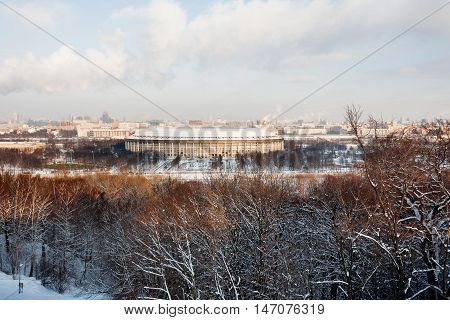 Panorama view on Luzhniki stadium and Sparrow Hills from observation deck near Moscow State Univercity (MSU). Winter sunny day. Moscow Russia.