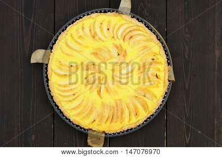 Apple tart with bake paper overhead view closeup