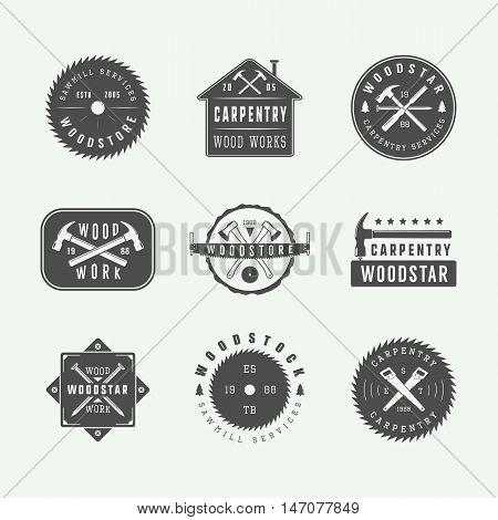 Set of vintage carpentry and mechanic labels emblems and logo. Graphic Art. Vector Illustration.