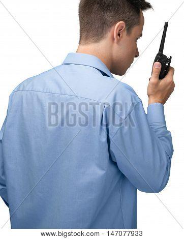 Portrait of a Man Using a Walkie-Talkie