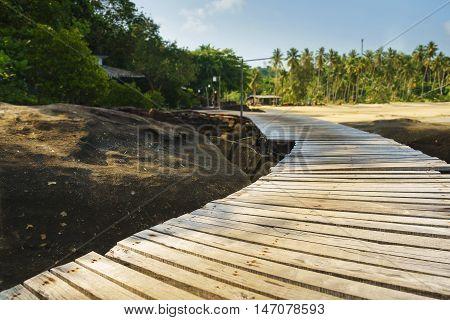 long curve wood bridge way with sun shade