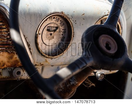 Speedometer and dashboard of an old wreck car left on a Namib desert.