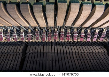 inside  a piano , wooden parts, mechanisms closeup
