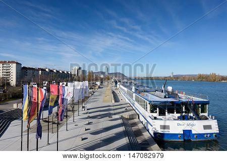 VIENNA, AUSTRIA - NOVEMBER 14, 2015: Danube river view with ferryboat in Vienna, Austria