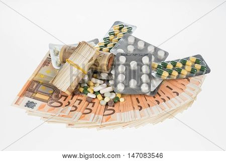 Fan from fifty euros and medical tablets. Many mass currency isolated on white background. Euro cash. Money for the purchase of medicines drugs or narcotic. Bill and pills
